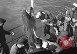 Image of U.S. sailors test fire hose on an LST Portland England United Kingdom, 1944, second 6 stock footage video 65675051842