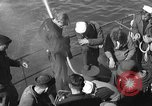 Image of U.S. sailors test fire hose on an LST Portland England United Kingdom, 1944, second 8 stock footage video 65675051842