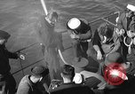 Image of U.S. sailors test fire hose on an LST Portland England United Kingdom, 1944, second 10 stock footage video 65675051842