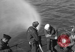Image of U.S. sailors test fire hose on an LST Portland England United Kingdom, 1944, second 18 stock footage video 65675051842