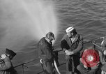 Image of U.S. sailors test fire hose on an LST Portland England United Kingdom, 1944, second 19 stock footage video 65675051842
