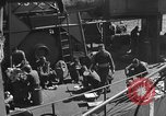 Image of U.S. sailors test fire hose on an LST Portland England United Kingdom, 1944, second 45 stock footage video 65675051842