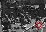 Image of U.S. sailors test fire hose on an LST Portland England United Kingdom, 1944, second 46 stock footage video 65675051842