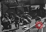 Image of U.S. sailors test fire hose on an LST Portland England United Kingdom, 1944, second 47 stock footage video 65675051842