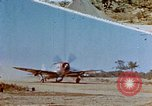 Image of Pilot examines flak damage to his P-47 aircraft Corsica France, 1944, second 1 stock footage video 65675051897