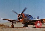 Image of Pilot examines flak damage to his P-47 aircraft Corsica France, 1944, second 7 stock footage video 65675051897