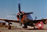 Image of Pilot examines flak damage to his P-47 aircraft Corsica France, 1944, second 8 stock footage video 65675051897