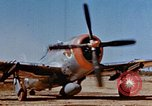 Image of Pilot examines flak damage to his P-47 aircraft Corsica France, 1944, second 9 stock footage video 65675051897