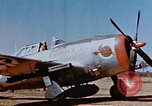 Image of Pilot examines flak damage to his P-47 aircraft Corsica France, 1944, second 10 stock footage video 65675051897
