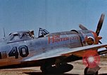 Image of Pilot examines flak damage to his P-47 aircraft Corsica France, 1944, second 12 stock footage video 65675051897