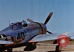 Image of Pilot examines flak damage to his P-47 aircraft Corsica France, 1944, second 14 stock footage video 65675051897