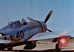 Image of Pilot examines flak damage to his P-47 aircraft Corsica France, 1944, second 15 stock footage video 65675051897