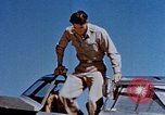Image of Pilot examines flak damage to his P-47 aircraft Corsica France, 1944, second 17 stock footage video 65675051897