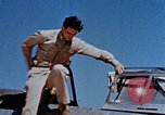 Image of Pilot examines flak damage to his P-47 aircraft Corsica France, 1944, second 18 stock footage video 65675051897