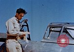 Image of Pilot examines flak damage to his P-47 aircraft Corsica France, 1944, second 19 stock footage video 65675051897