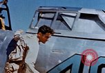 Image of Pilot examines flak damage to his P-47 aircraft Corsica France, 1944, second 20 stock footage video 65675051897
