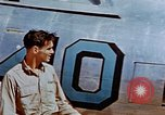 Image of Pilot examines flak damage to his P-47 aircraft Corsica France, 1944, second 21 stock footage video 65675051897