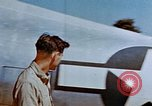 Image of Pilot examines flak damage to his P-47 aircraft Corsica France, 1944, second 22 stock footage video 65675051897