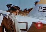 Image of Pilot examines flak damage to his P-47 aircraft Corsica France, 1944, second 23 stock footage video 65675051897