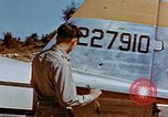 Image of Pilot examines flak damage to his P-47 aircraft Corsica France, 1944, second 24 stock footage video 65675051897
