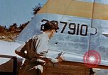 Image of Pilot examines flak damage to his P-47 aircraft Corsica France, 1944, second 25 stock footage video 65675051897