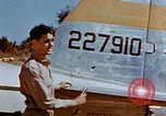 Image of Pilot examines flak damage to his P-47 aircraft Corsica France, 1944, second 26 stock footage video 65675051897