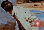 Image of Pilot examines flak damage to his P-47 aircraft Corsica France, 1944, second 28 stock footage video 65675051897