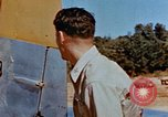Image of Pilot examines flak damage to his P-47 aircraft Corsica France, 1944, second 29 stock footage video 65675051897