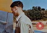 Image of Pilot examines flak damage to his P-47 aircraft Corsica France, 1944, second 30 stock footage video 65675051897