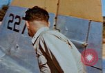 Image of Pilot examines flak damage to his P-47 aircraft Corsica France, 1944, second 31 stock footage video 65675051897