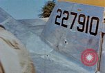 Image of Pilot examines flak damage to his P-47 aircraft Corsica France, 1944, second 32 stock footage video 65675051897