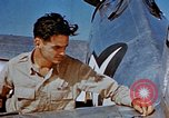 Image of Pilot examines flak damage to his P-47 aircraft Corsica France, 1944, second 34 stock footage video 65675051897