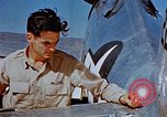 Image of Pilot examines flak damage to his P-47 aircraft Corsica France, 1944, second 35 stock footage video 65675051897