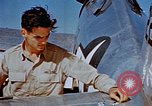 Image of Pilot examines flak damage to his P-47 aircraft Corsica France, 1944, second 36 stock footage video 65675051897