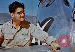 Image of Pilot examines flak damage to his P-47 aircraft Corsica France, 1944, second 38 stock footage video 65675051897