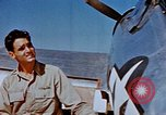 Image of Pilot examines flak damage to his P-47 aircraft Corsica France, 1944, second 39 stock footage video 65675051897