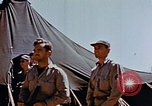Image of Pilot examines flak damage to his P-47 aircraft Corsica France, 1944, second 41 stock footage video 65675051897