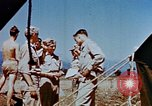 Image of Pilot examines flak damage to his P-47 aircraft Corsica France, 1944, second 48 stock footage video 65675051897
