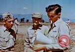 Image of Pilot examines flak damage to his P-47 aircraft Corsica France, 1944, second 49 stock footage video 65675051897