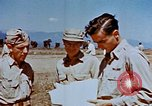 Image of Pilot examines flak damage to his P-47 aircraft Corsica France, 1944, second 51 stock footage video 65675051897