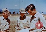 Image of Pilot examines flak damage to his P-47 aircraft Corsica France, 1944, second 52 stock footage video 65675051897