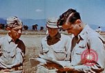 Image of Pilot examines flak damage to his P-47 aircraft Corsica France, 1944, second 53 stock footage video 65675051897