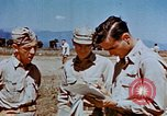 Image of Pilot examines flak damage to his P-47 aircraft Corsica France, 1944, second 54 stock footage video 65675051897