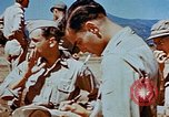 Image of Pilot examines flak damage to his P-47 aircraft Corsica France, 1944, second 58 stock footage video 65675051897
