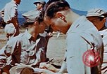 Image of Pilot examines flak damage to his P-47 aircraft Corsica France, 1944, second 61 stock footage video 65675051897