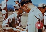 Image of Pilot examines flak damage to his P-47 aircraft Corsica France, 1944, second 62 stock footage video 65675051897