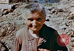 Image of Italian civilians in bombed out town Italy, 1944, second 23 stock footage video 65675051902