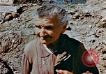 Image of Italian civilians in bombed out town Italy, 1944, second 24 stock footage video 65675051902