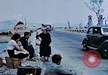 Image of Italian civilians in bombed out town Italy, 1944, second 26 stock footage video 65675051902