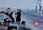 Image of Italian civilians in bombed out town Italy, 1944, second 27 stock footage video 65675051902